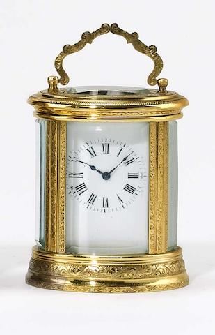 A good early-20th Century French engraved oval miniature carriage clock,
