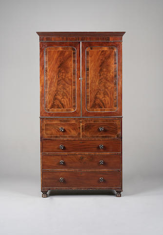 A Regency flame mahogany and rosewood cross banded secretaire linen press