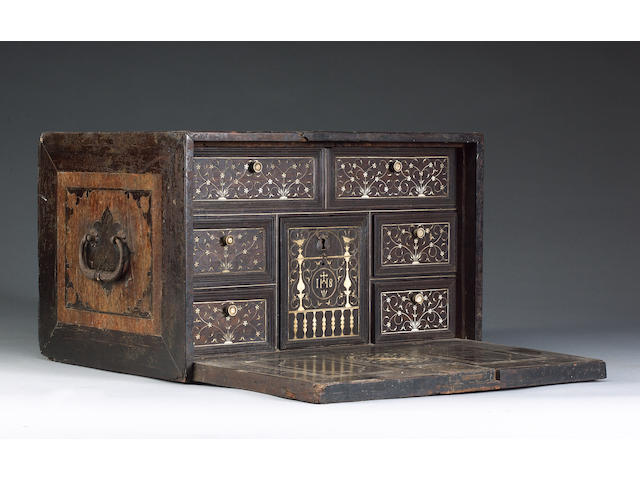 A late 17th / early 18th century Indo Portuguese ivory and ebony table cabinet