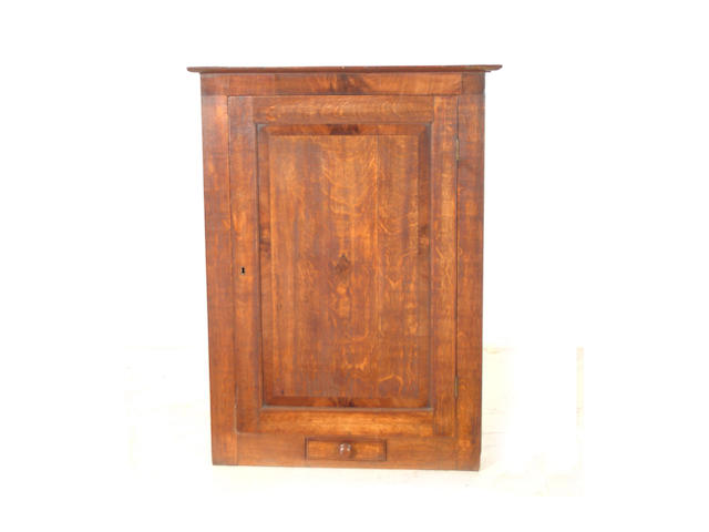 An 18th Century oak and mahogany hanging corner cupboard