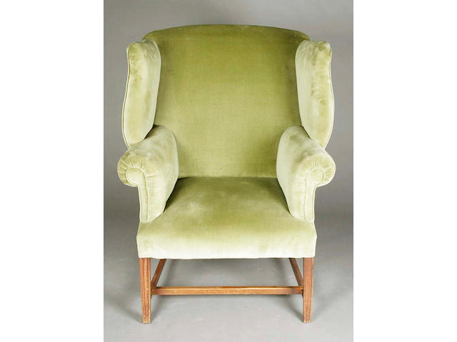 A large George III upholstered wing and roll armchair,