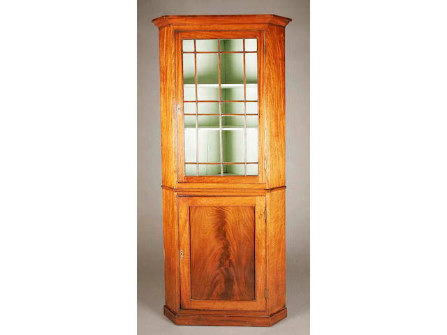 A 19th century George III style mahogany floorstanding corner cupboard,