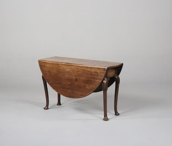 A George II oak drop leaf table
