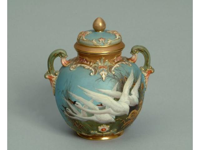 A Royal Worcester two handled vase and cover