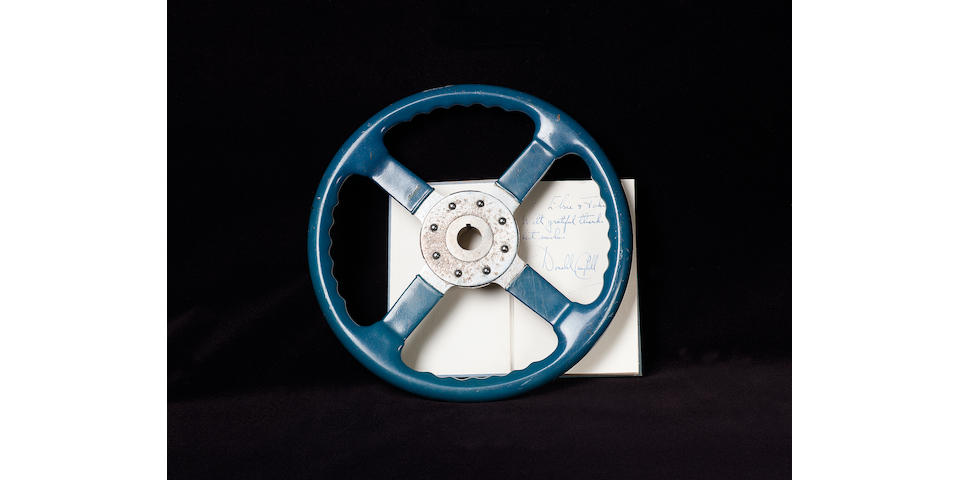 The steering wheel used in Donald Campbell's Bluebird K4 and K7 record breaking crafts, by Bluemels,
