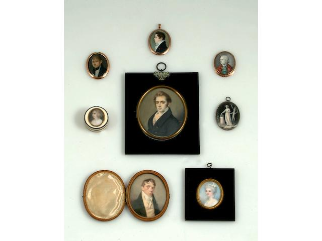 English School (circa 1810) A portrait miniature of a young gentleman, in profile, wearing a navy jacket and white stock, head and shoulders, oval