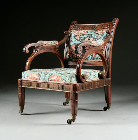 A good George IV mahogany library armchair