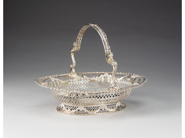 A George III silver oval swing-handled basket, maker's mark I L with pellet between, in a rectangular wavy edged punch, see Jacksons page 260, 3652, London 1774,