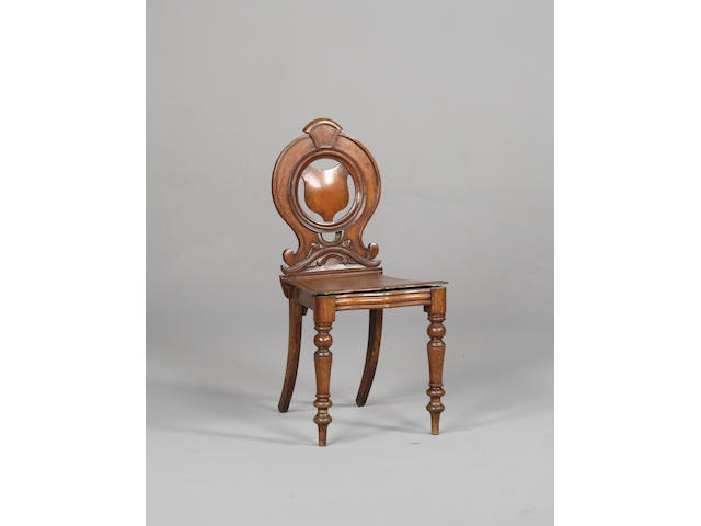 A Victorian oak hall chair.