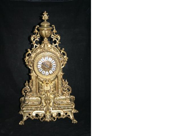A large late 19th Century French gilt-bronze mantel clock garniture set,