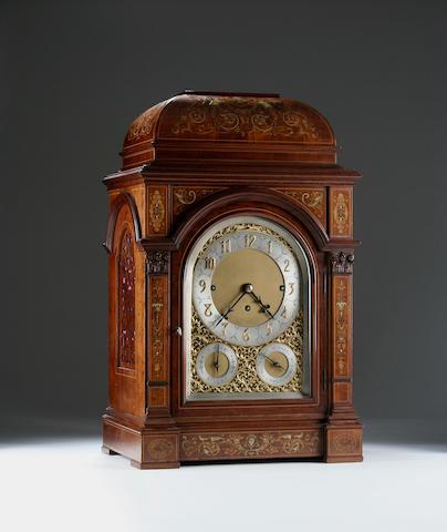 An imposing Edwardian mahogany and inlaid chiming and repeating bracket clock,
