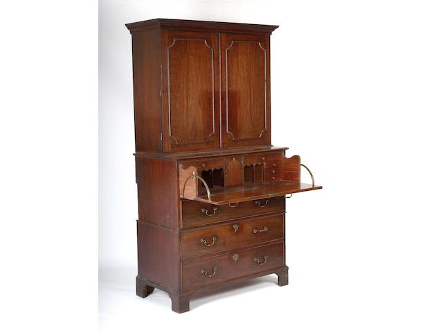 A George III mahogany secretaire cabinet