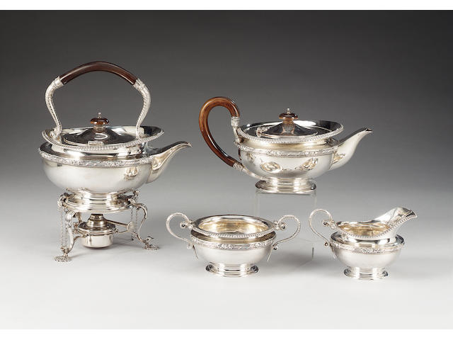 A  silver four piece tea service including kettle on stand, by Mappin & Webb, London 1916,