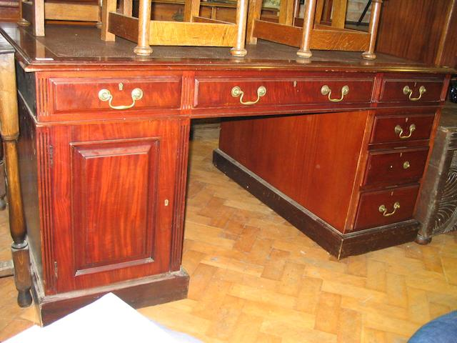 A late 19th Century mahogany partners desk,