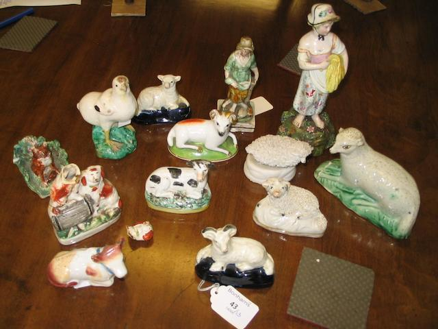 A group of early to mid 19th century Staffordshire figures and animals