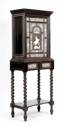 A 19th Century French ebonized and ivory inlaid cabinet