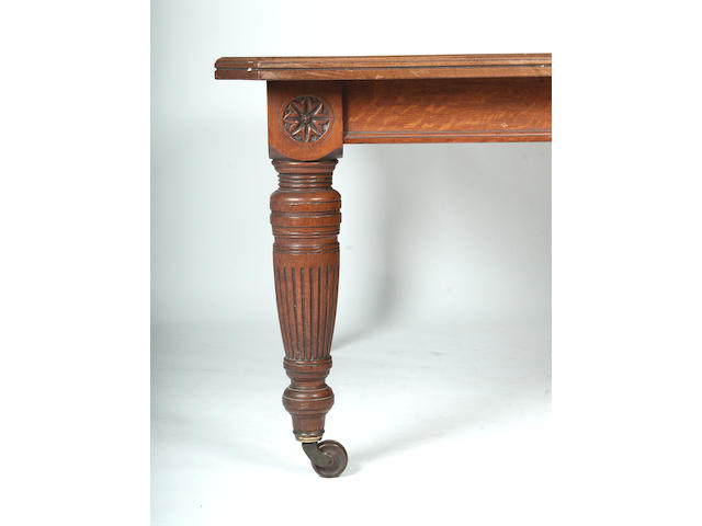 A late Victorian oak extending dining table