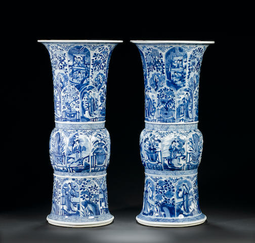 A very fine pair of blue and white trumpet vases, gu Kangxi