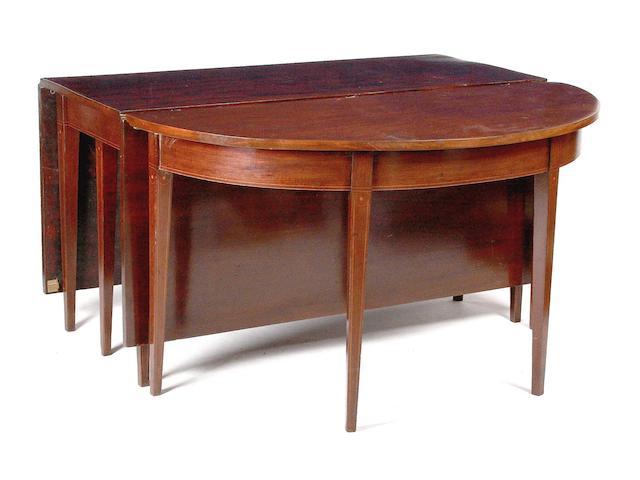 A Regency mahogany demi-lune dining table