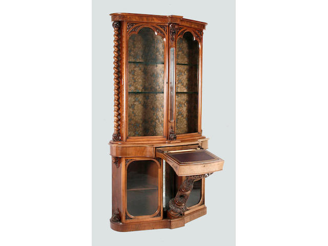A late Victorian walnut bookcase and writing cabinetof exhibition quality reputedly made by Mr W F Stanley