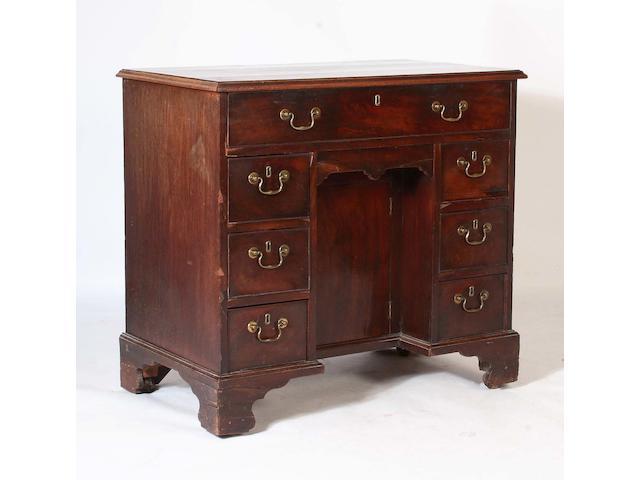 A mahogany kneehole dressing table