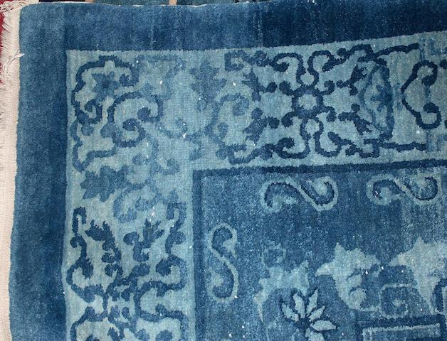 A 20th Century Chinese carpet 244cm x 300cm.