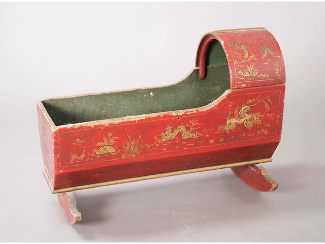 A late 18th/early 19th century scarlet lacquered pine cradle,