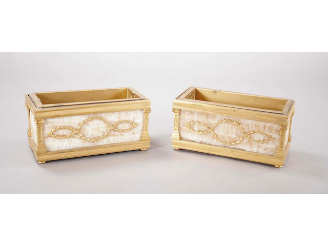 A pair of late 19th century French gilt bronze and brown onyx inset rectangular jardinieres