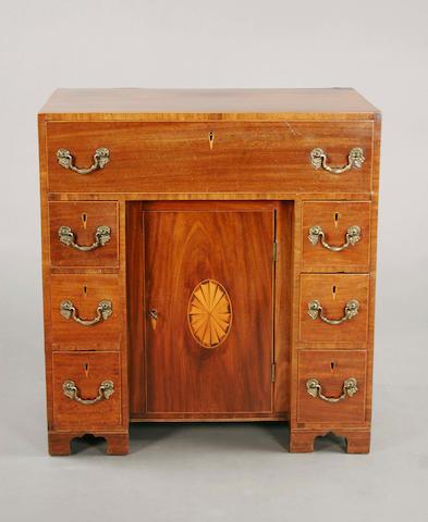 A George III mahogany and boxwood line edged kneehole desk