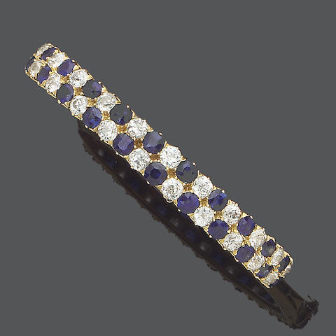 A late 19th century sapphire and diamond bangle,
