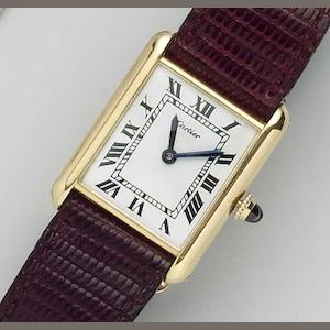 Cartier. An 18ct gold watch with deployant clasp  Tank