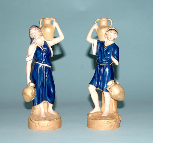A pair of Royal Dux figures of water carriers circa 1900,