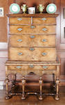 An early 18th century and later figured walnut chest on stand