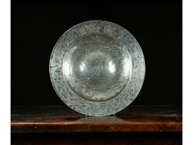 An important engraved bossed dish, circa 1640