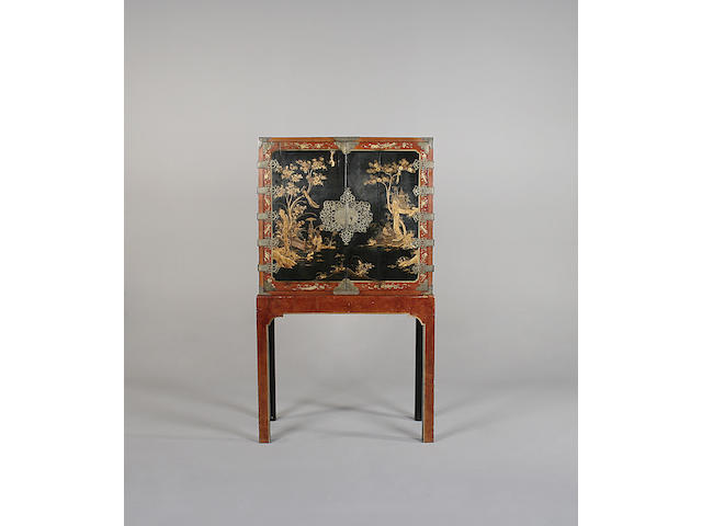 An early 18th century black and gold Chinese lacqured cabinet on later 18th century English stand