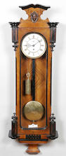 A late 19th century Vienna regulator style walnut and part ebonised wall timepiece