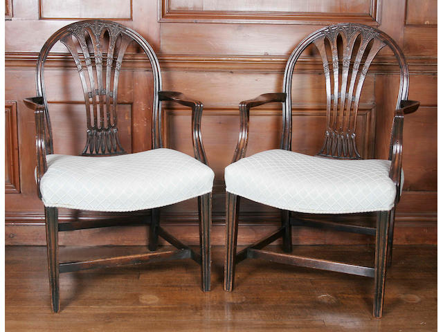 A pair of George III style carved mahogany elbow chairs,