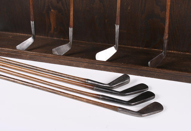 A collection of smooth faced late 19th and early 20th Century irons,