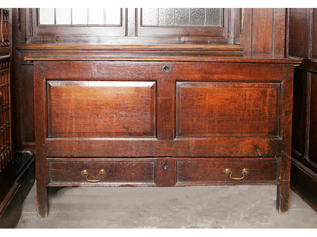 An early 18th century oak twin panel mule chest,