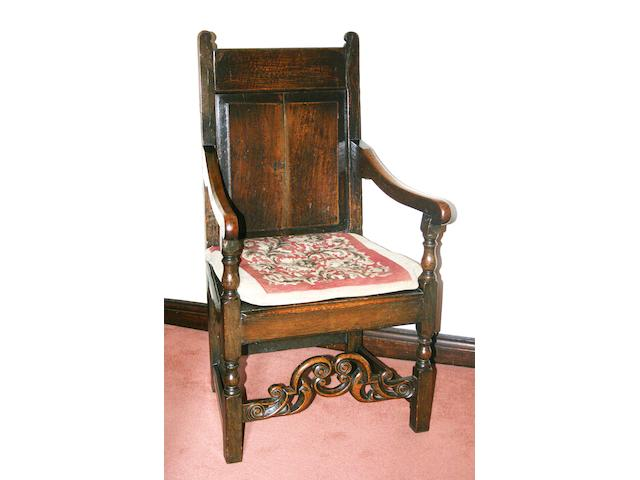 An 18th century and later oak Wainscot elbow chair,