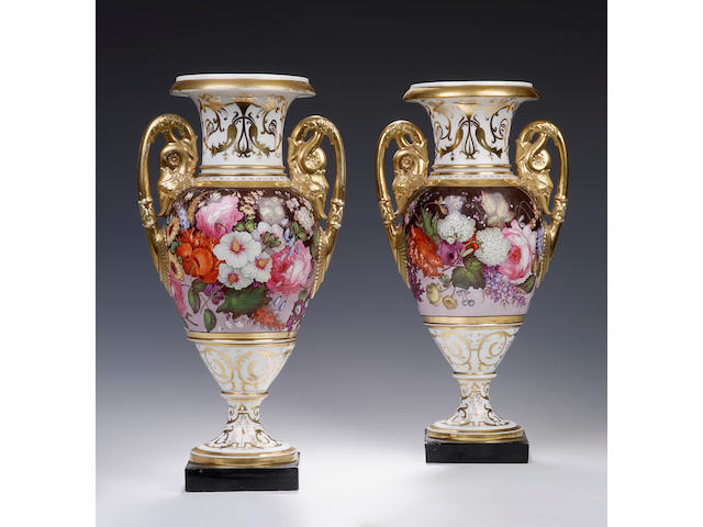 A pair of two handled white and gilt vases, possibly Coalport Circa 1815 - 1820