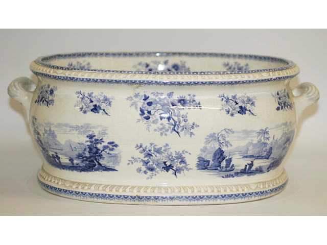 A Staffordshire blue and white oval twin handled foot bath