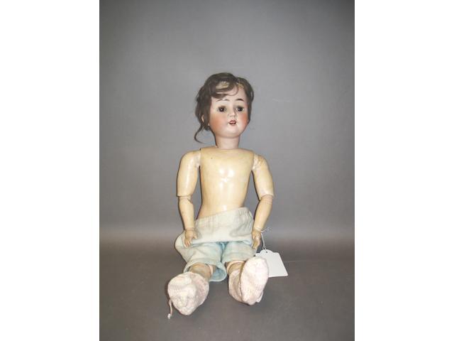 Bisque head girl doll, circa 1910,