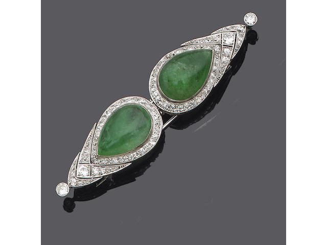 An art deco emerald and diamond double-clip brooch,