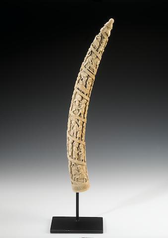 A large Loango ivory tusk pale honey-coloured patina, 59cm.