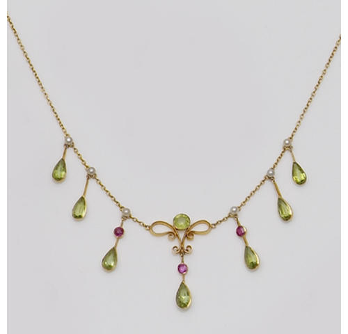 An Edwardian peridot, ruby and pearl fringe necklace