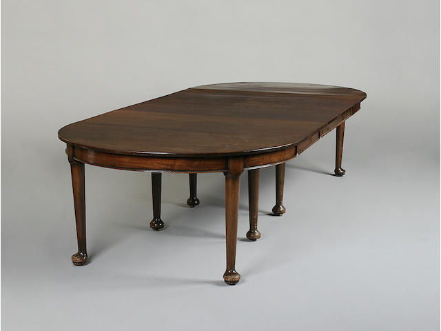 A large early 20th century mahogany dining table in the George II style