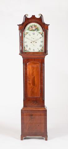 An early 19th century mahogany longcase clock