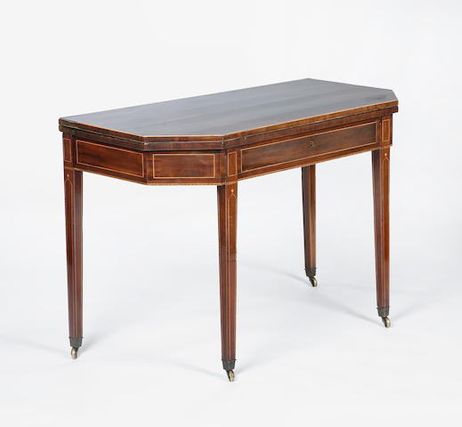 An Edinburgh George III mahogany and boxwood strung fold over tea table with characteristic octagon top and gothic dot inlay