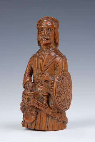 An early 18th century carved boxwood snuff mull in the form of a Highlander